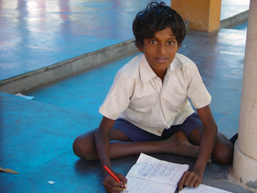 A hard-working student at Olcott Memorial, funded in part by Asha for Education. Click for a larger version.
